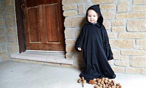 A young child dressed as a monk