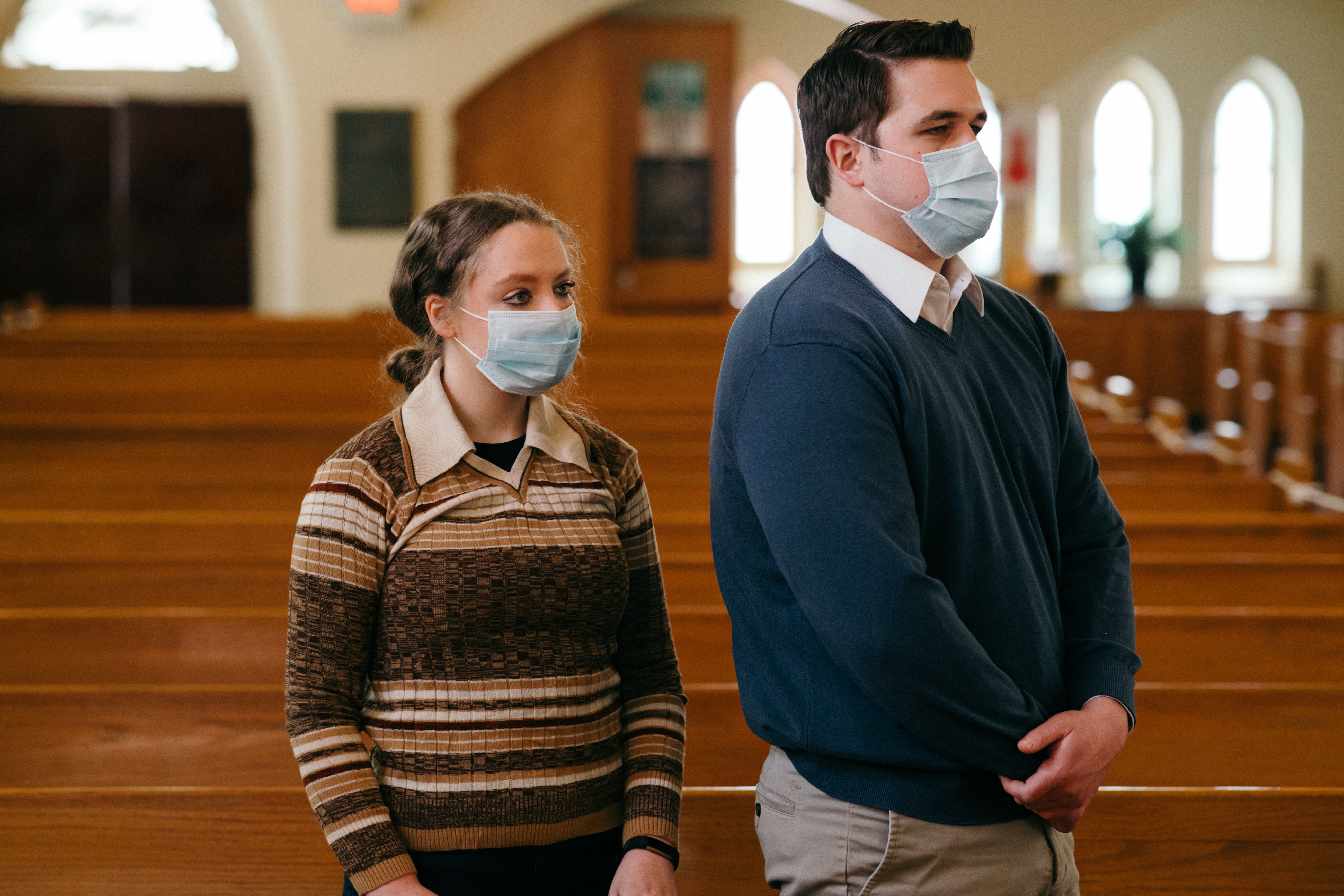 Couple in  church wearing masks