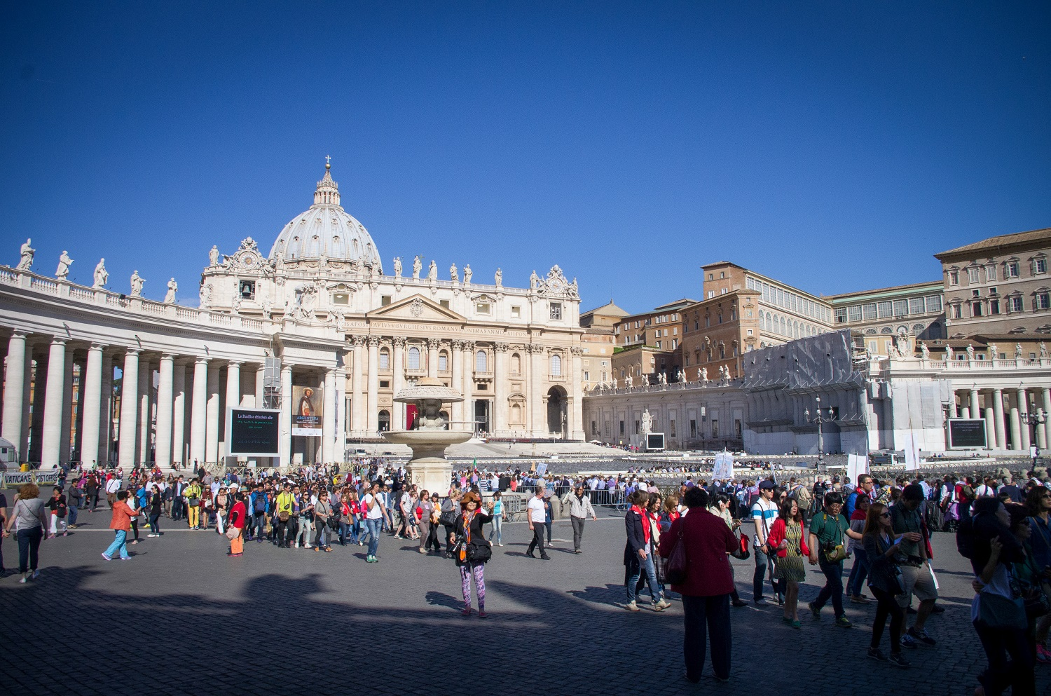 The Vatican with crowds during the day