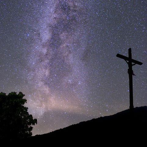 Crucifix by the night sky