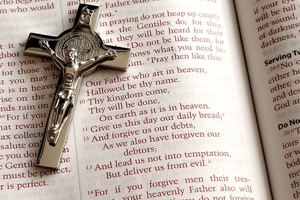 Cross with an open Bible