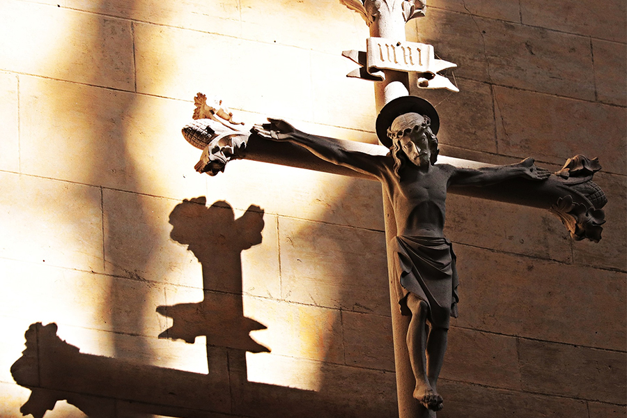 Crucifix in sun and shadows