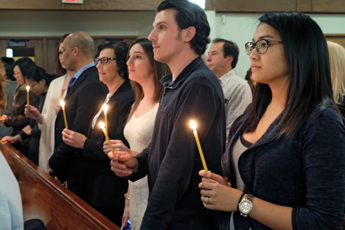 Group holding candles at church