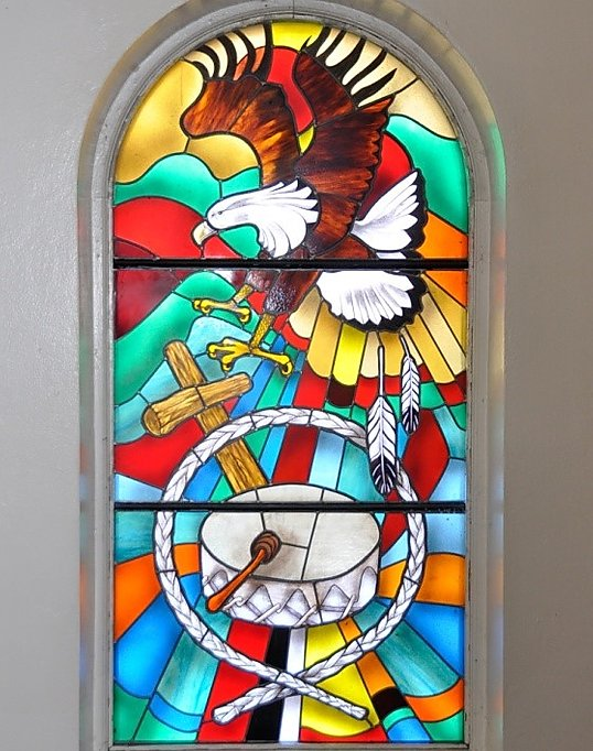 Native American imagery on stained glass window