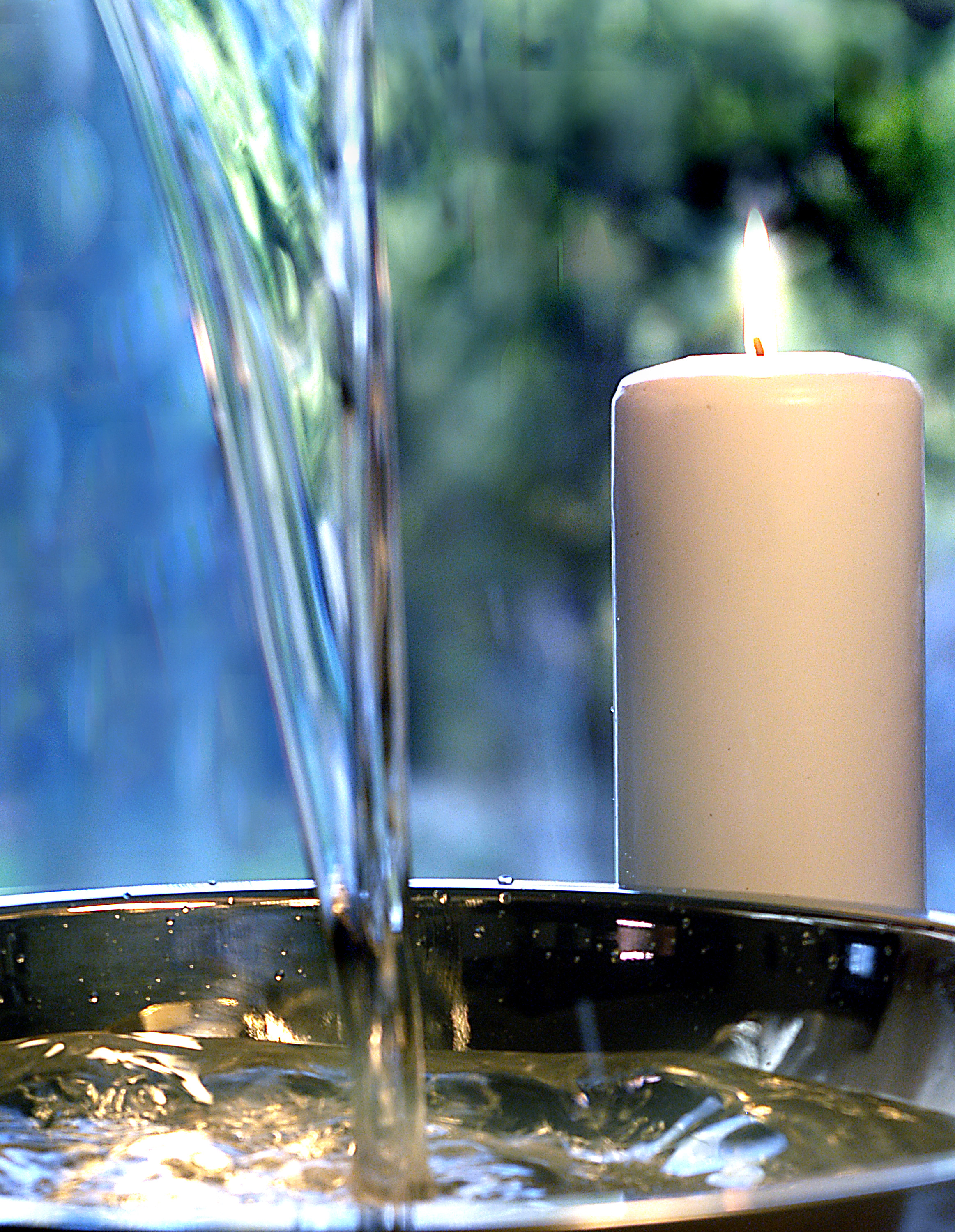 Candle with flowing water