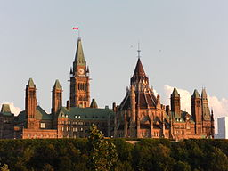 The exterior of Parliament Hill in Ottawa at dusk