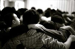 A group of teenage boys in a huddle