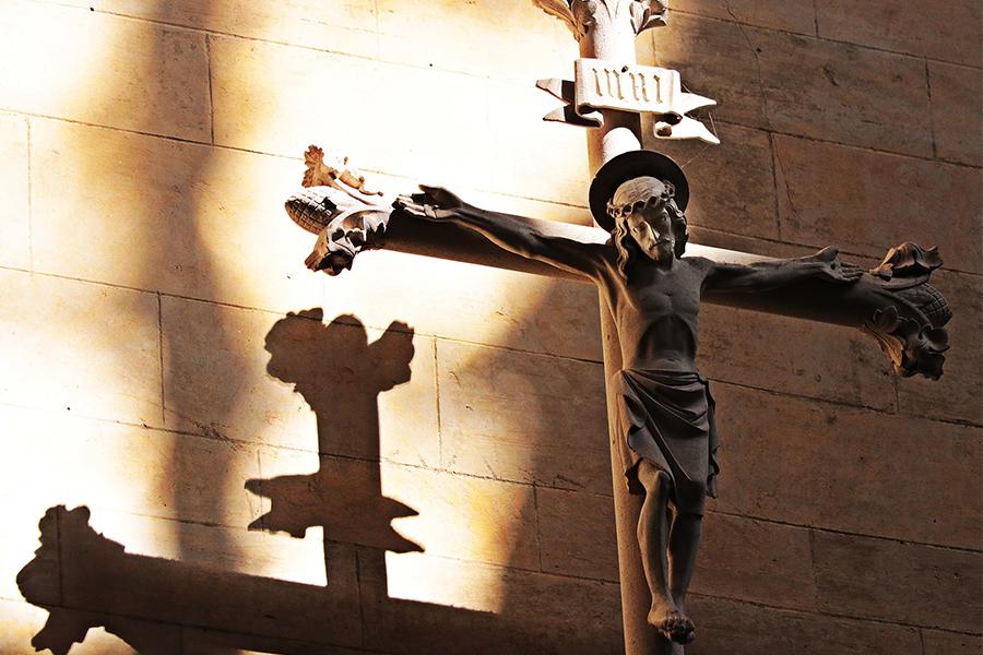 Crucifix in sun and shadows