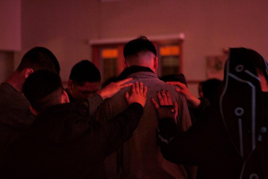 Group praying over man