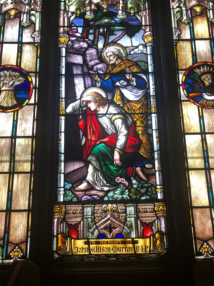 A stained glass window at St. Peter's Parish depicting Peter and John seeing Jesus' empty tomb