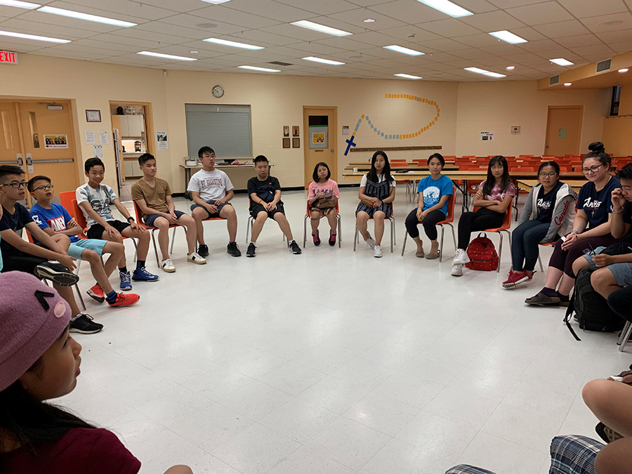 Youth group sitting around in a circle