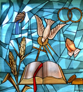 stained glass window style image of Holy Spirit dove flying down into a bible