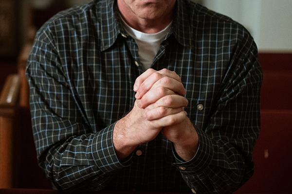 Praying hands at church